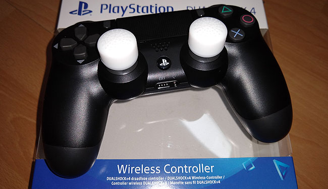 PS4 lightweight controller with thumb-stick extensions.