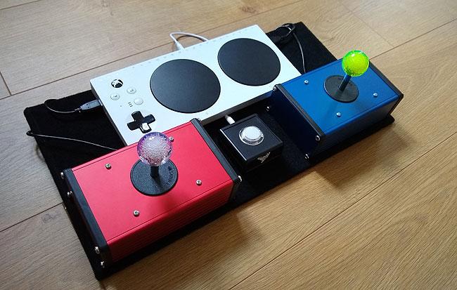 Ultrastik analogue joysticks in aluminium boxes with an Xbox Adaptive Controller.