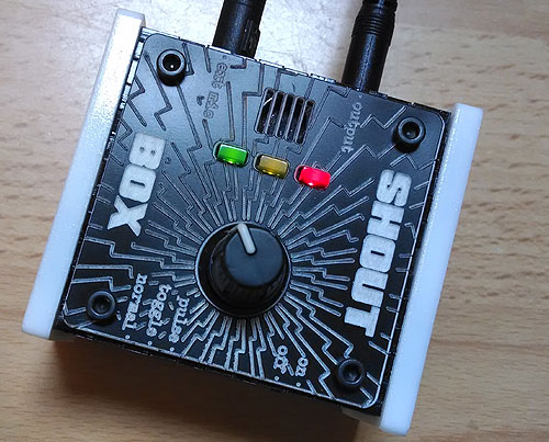 OneSwitch Shout Box by Jason Hotchkiss. Black and white small box of electronics, with dial, three LED lights and a microphone grill.