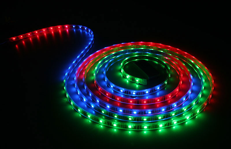 1D Pong. Coiled light strip of rainbow colours.