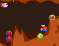 Retro cave system with a pink bullet shooting through it. Fruit in orbs scattered on the cave floor.