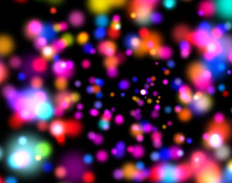 Cause and Effect: Lightbox image of coloured speckles.