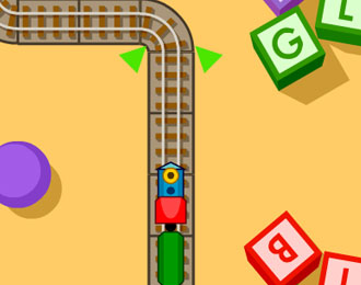 Toy train on tracks near some toy blocks with letters.