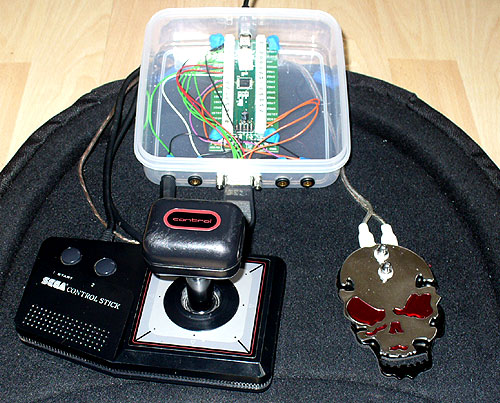 Image of a DIY AT Interface with SEGA Control Stick and Skull Tattoo pedal. Affordable asstive technology.