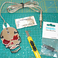 Image of skull tattoo switch, knife, 3.5mm plug and SUGRU 5g pouch.