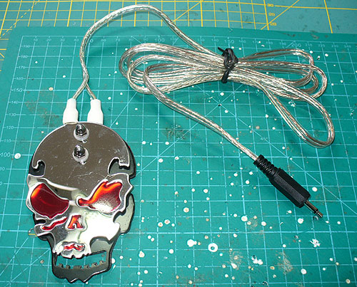 Image of a skull tattoo switch, adapted for use with switch adapted assistive technology.