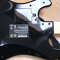 2. Flip the Guitar over so you can unscrew the black casing.