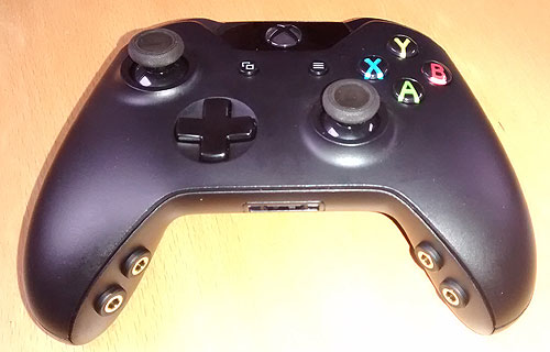 Xbox One original style joypad adapted for lighter use and switch access.