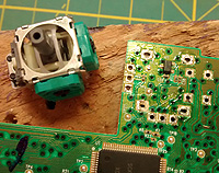 Solder points on the PCB for one side of the joypad motors.