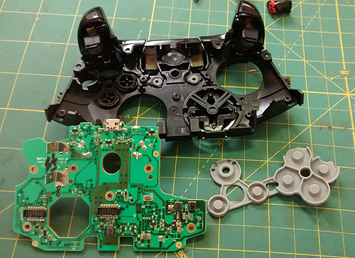 Xbox One removed PCB and rubber-boots removed.