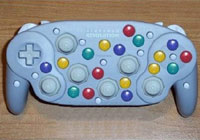 Joke image of a Joy Pad controller with about 30 buttons.