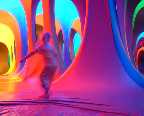 Dreamspace: Coloured archways. Katie spins in the middle of them all.