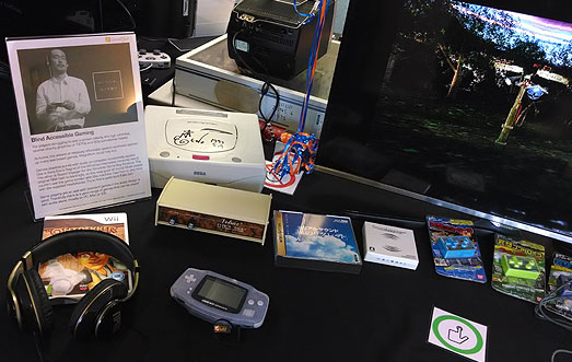 Blind accessible gaming display. Includes a Votrax speech synthesiser from 1981, Mousou audiogames, Warp's Regret of the Wind, Kenji Eno signed SEGA Saturn and Sound Voyager on a GBA with headphones.