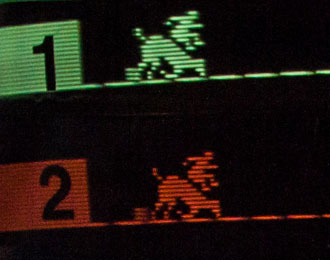 Close up of two horses falling in Atari's 1975 arcade game Steeplechase.
