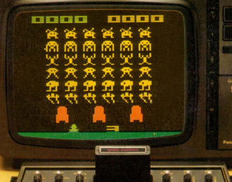 Atari Space Invaders on a colour TV.