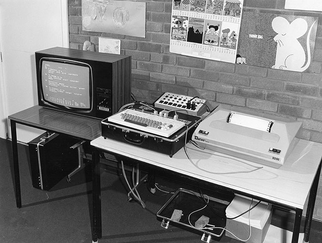 MAVIS Mk.II computer by Ferranti (circa 1979). Colour TV to the left with questionnaire displayed. Interface box back. Printer right. A couple of foam switches under the table.