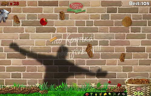 A screenshot of Paximadaki, a Kinect game made broadly far more accessible than normal. The image here is of a human shadow against a brick wall, trying to guide falling food into a basket.